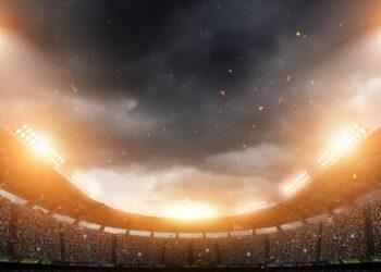 maior time do brasil: Estádio de futebol em visão panorâmica com luzes acesas
